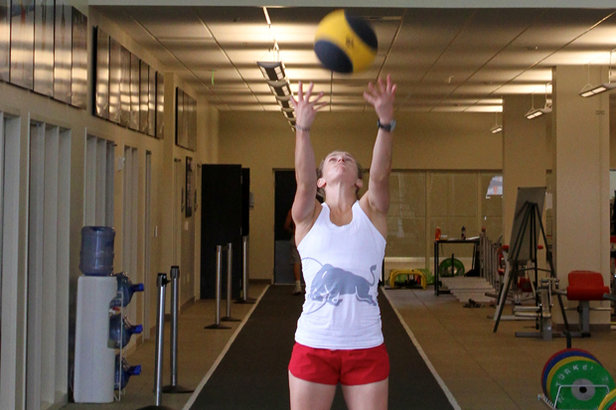 Heather McPhie doing an overhead ball throw.