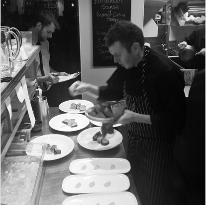 Chef Nick lining up food for Alta Bistro's first New Years Eve party.