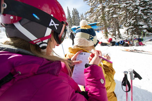 Ski tester Susan Minneci fills out a tester card in between testing skis.