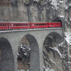 Take a panoramic train ride from St. Moritz on the Glacier Express.  - © Martha de Jong-Lantink