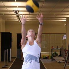 Heather McPhie doing an overhead ball throw. - ©Tim Shisler