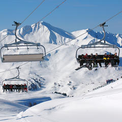 Taking the lifts in La Plagne. The Paradiski area is favourite with UK skiers - © Beatrice Koumanov