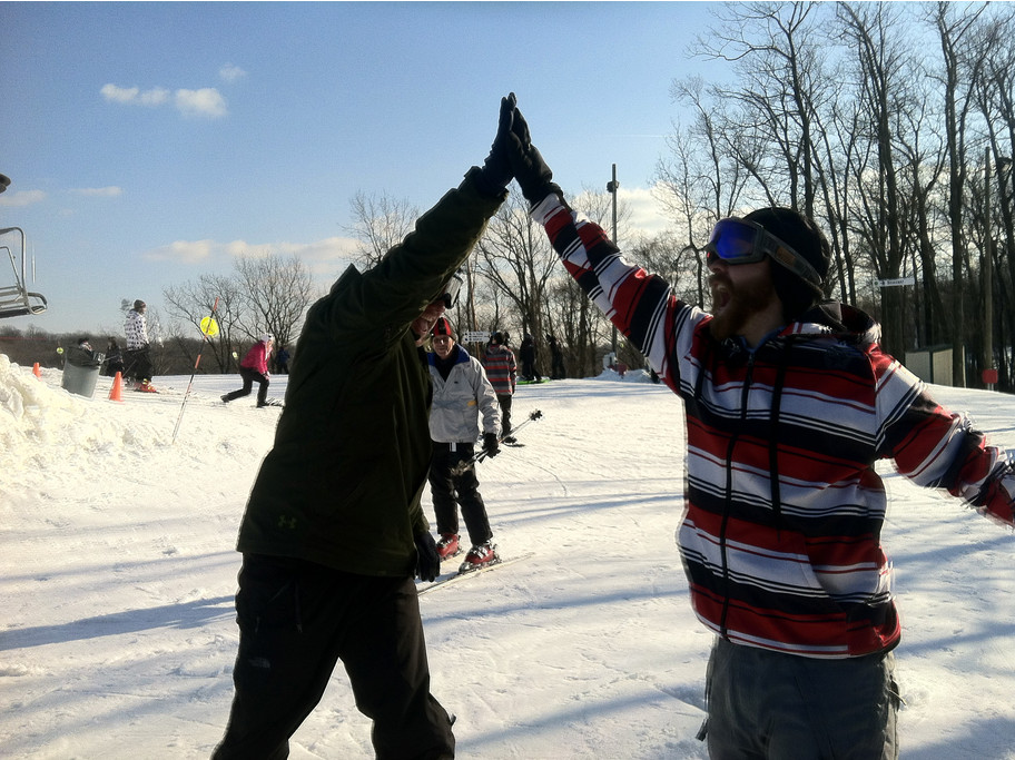 Bring a first-time friend along and you can both score during Learn to Ski and Snowboard Month. High five! Photo Courtesy of Bear Creek Resort.undefined